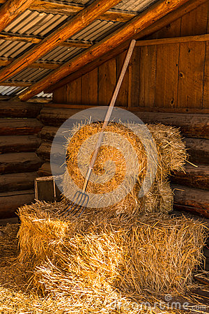 Free Bales Of Straw Hay With Pitchfork In Barn Stock Photos - 33138793