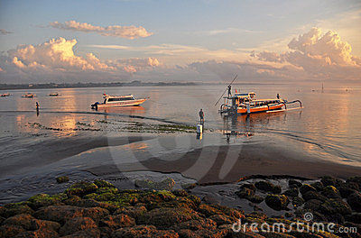 Bali Fishermen Prepare their Boat at Dawn Editorial Stock Image