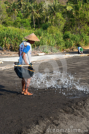 Traditional sea salt production on on the volcanic black sand, B Editorial Stock Image