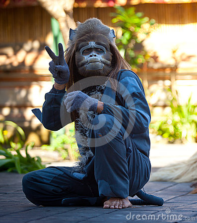 Balinese actor - Monkey during a dance Barong Editorial Photo