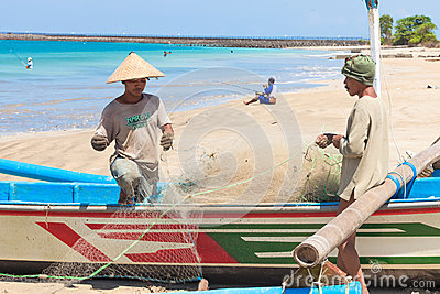 Balinese fishermen Editorial Stock Image