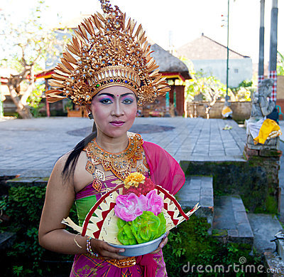 Balinese girl posing for turists Editorial Stock Photo