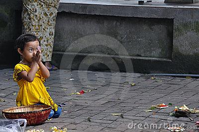 Balinese girl praying Editorial Stock Image