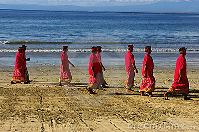 Balinese Hindu men on the beach Editorial Image