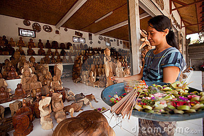 Balinese woman makes an offering to the gods Editorial Stock Image