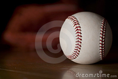 Ball and baseball glove.