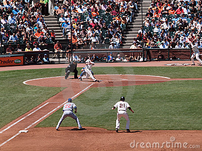 Ball bounces off ground as Aubrey Huff hits pitch Editorial Photo