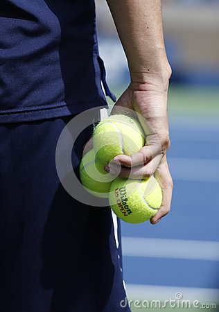 Ball boy holding Wilson tennis balls at the Billie Jean King National Tennis Center