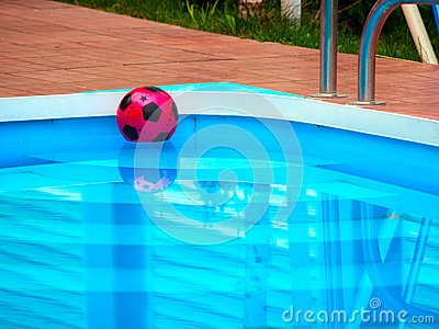 Ball is floating in swimming pool