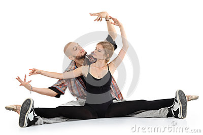 Ballerina and bald breakdancer sit on floor