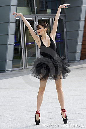 Ballerina in black tutu outdoor