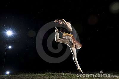 Ballerina dancer at night, outdoors