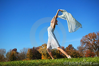 Ballerina dancing in field
