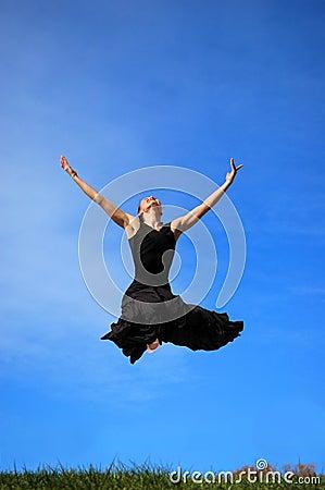Ballerina jumping midair