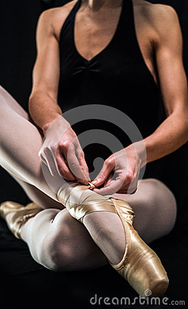 Free Ballerina Preparing Her Ballet Shoes Stock Image - 29110771