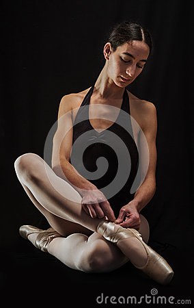 Free Ballerina Preparing Her Ballet Shoes Stock Images - 29110874
