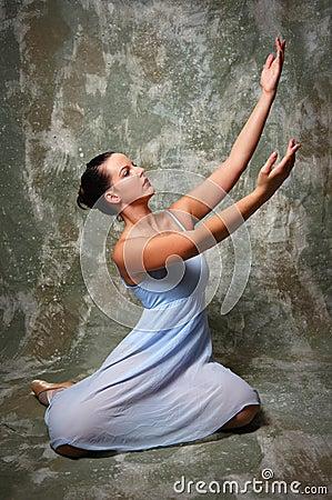 Ballerina with raised hands