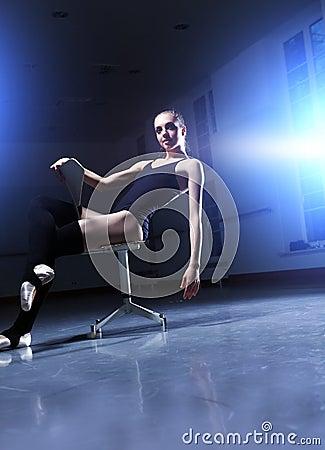 Ballerina is relaxing in class room