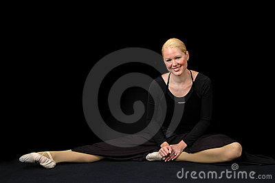 Ballerina resting and smiling