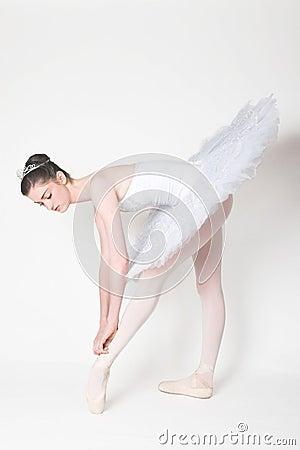 Free Ballerina Tying Her Shoe Royalty Free Stock Photo - 4250405