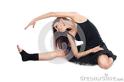 Ballet dancer in black dress doing exercises