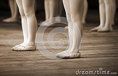 Ballet school fragment with little girls legs