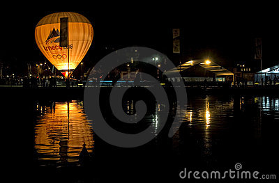 Balloon and its reflection at Annecy lake. Editorial Stock Image