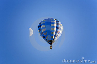 Balloon and moon on the blue sky
