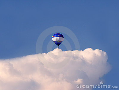 Balloon over a cloud