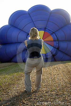 Balloonist inflating balloon