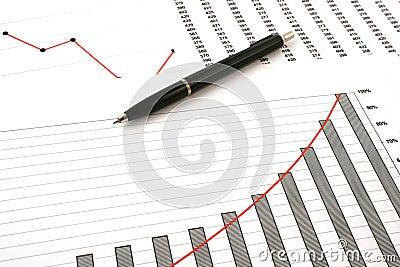 Ballpoint pen on earning graphs