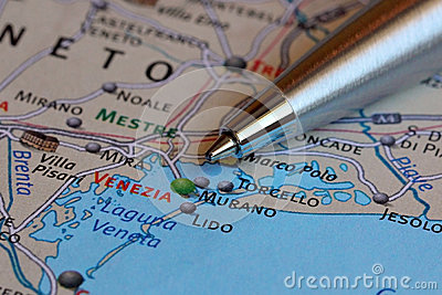 Ballpoint Pen Pointing at Venice on a Map of Italy