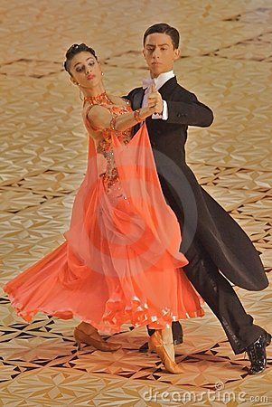 Ballroom Dancers Orange Gown Editorial Image