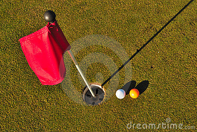 Balls golf next to to hole