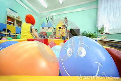 Balls lie in container; kids play