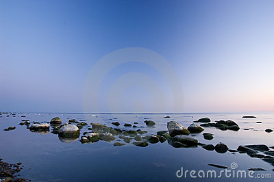 Baltic seaside with stones after sunset
