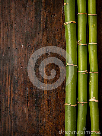 Free Bamboo On Wood Background Royalty Free Stock Photos - 30003628