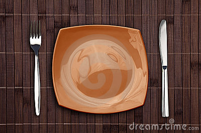 Bamboo placemat with square plate fork and knife