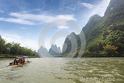 Bamboo raft and  karst mountain landscape