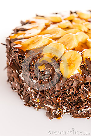 Banana dessert cake with dark chocolate topping