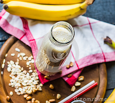 Free Banana Smoothie With Oat Flakes And Milk In The Bottle Stock Image - 47650471
