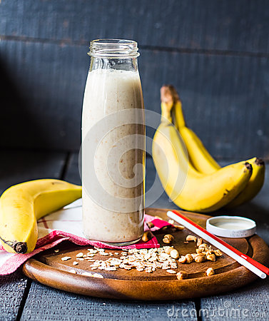 Free Banana Smoothie With Oat Flakes And Milk In The Bottle Royalty Free Stock Photos - 47650488
