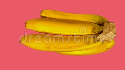 Bananas on different backgrounds. A video showing a bunch of bananas with several different solid color backgrounds stock video