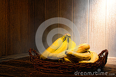 Bananas on Old Wood Table in Vintage Kitchen