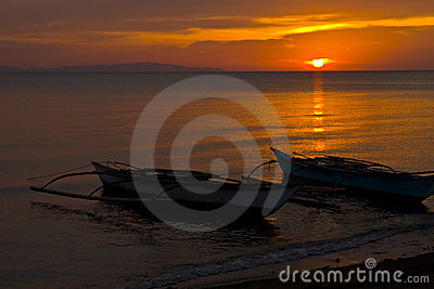 Banca Boats at Sunset on Beach