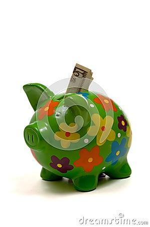 Banca piggy fiorita verde con soldi