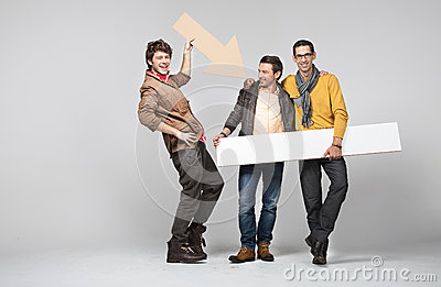 A band of male friends with signs