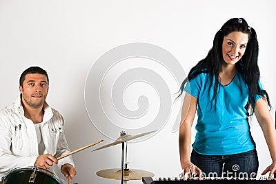 Band singing drums and organ