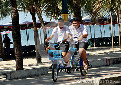 Bang Saen,Thailand: Students Riding Bicycle-Built-for-Two Editorial Stock Image