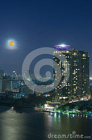 Bangkok cityscape. Bangkok river view with full moon at twilight